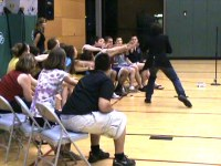 High School Stage Hypnotist Bruce James demonstrating hypnosis with his project graduation safe hypnotist show.